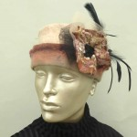 peach wet felted hat with flowers feather