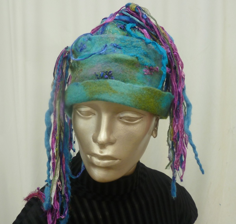 Felted Hat with yarn streamers in blues