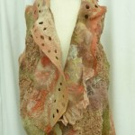 Orange Sherbet Nuno Felted Vest with large collar with felted holes and highly texture silks