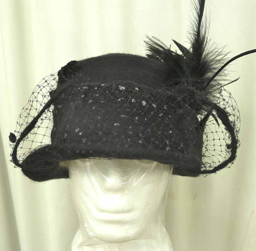black felted hat with feather_veil