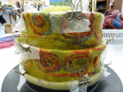 Making a wet felted hat using a resist