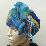 Collaged Blue Felted Hat with yarns button in blues gold
